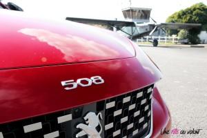 Peugeot 508 GT Line rouge ultimate logo capot